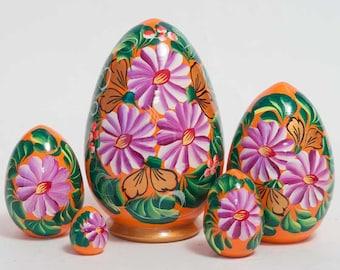Painted nesting eggs pink flowers on orange matryoshka egg - kod12p