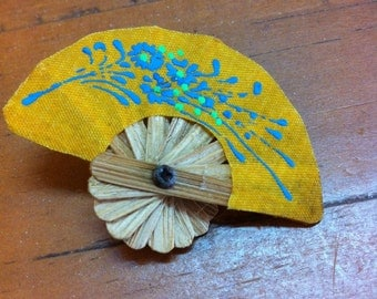 Oriental fan brooch with blue blossom detail