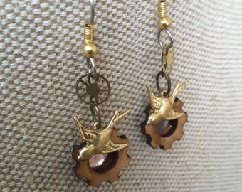 Steampunk swallow sparrow earrings with watchparts. Alchemy alice