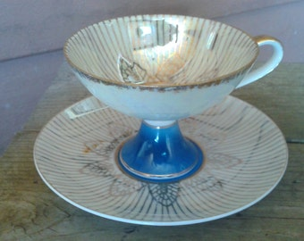 Blue, White and Gold Lusterware Teacup and Saucer Set