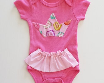 Body baby Fuchsia (3 months) with short skirt and Crown-shaped application