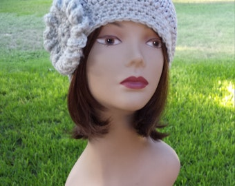 Winter crochet hat with flower made and designed by petronella