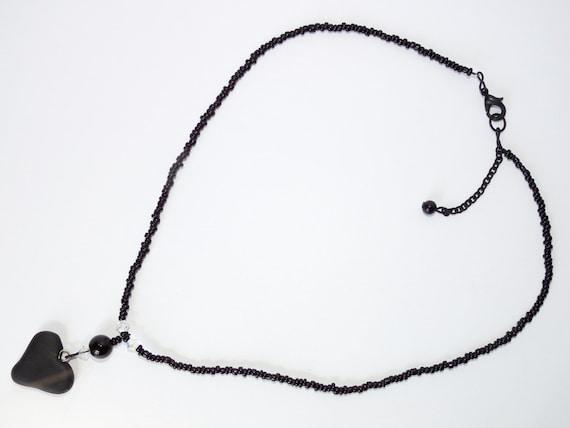 Onyx & Swarovski necklace with a handmade heart pendant of clay