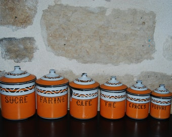 Set of 6 vintage French enamelware canisters with lids in an unusual orange and white. Kitchen spice canisters for display and storage.