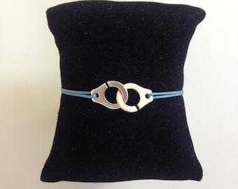 Bracelet cuffs on cordon Bleu. Style Dinh Van