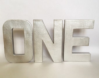metallic stand up one sign first birthday photo prop party decor paper mache letters winter onederland cake smash wild one decoration