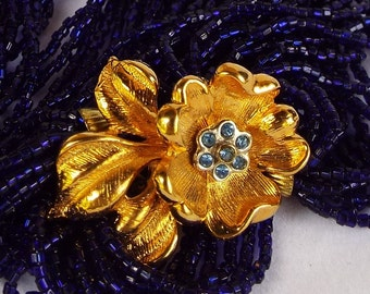 Vintage Mid Century Hollywood Glam Cobalt Blue Seed Bead Torsade Necklace with Gold Tone Rhinestone Flower Blossom Clasp