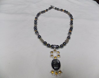 Hand made one of a kind Necklace W/ Tourmalated Quartz