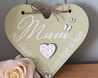 Mum not always eye to eye but always heart to heart. Hanging heart plaque