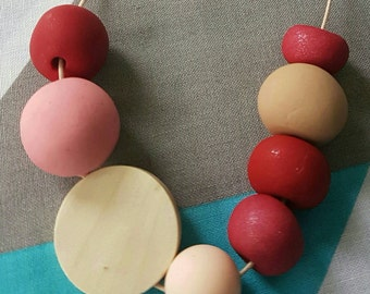 Handmade children's wooden, silicone and clay bead necklace.