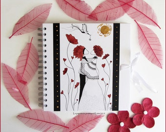 Guestbook shows wedding couple in red and black large poppies