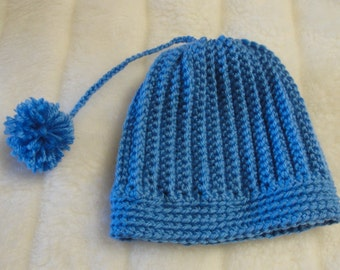 Warm Winter Hat for your toddler made in blue with a pom-pom. Handmade and crochet.