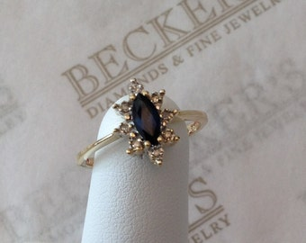 Vintage 10k yellow gold marquise blue Sapphire & 8 Diamond Starburst Halo Ring, .37 tw size 6.5
