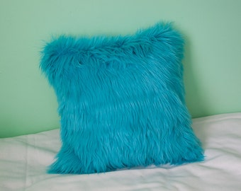 Luxurious long pile faux fur throw pillow in turquoise