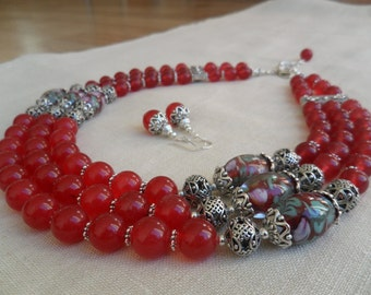 Natural red marble necklace with venetian glass beads and sterling silver earrings.