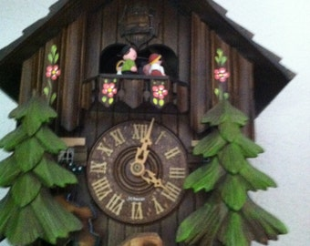 German Black Forest Chalet Cuckoo Clock with Dancers  Two songs