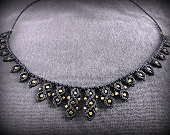 Black macrame necklace adorned with brass beads. For an everyday look or for the evening!