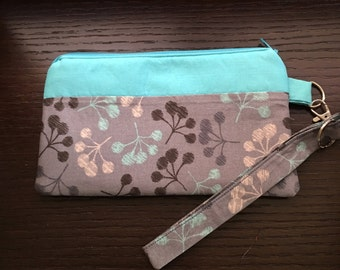 Teal colored Wristlet with small pocket