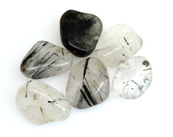 Tourmalinated quartz tumblestone crystal,  tourmaline  in quartz