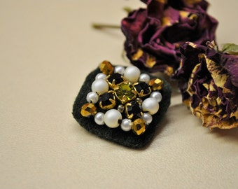 Very small embroidered brooch