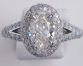 Beautiful 1.87 ctw Oval Cut Diamond Engagement Ring with a 1.20 Oval Cut J Color/SI2 Clarity Enhanced Center Diamond