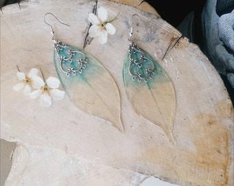 Earrings made of skeletonized leaves