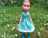 Repainted bratz doll with a hand made dress and shoes.