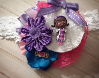 Fabric flower Doc McStuffins headband fascinator in purple and pink