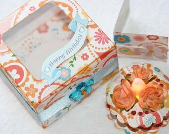 Tea light cake with coordinating cake box.