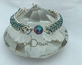 Silver chain maille bracelet with rainbow coloured pyrite dragonback: chain mail; chainmaille bracelet; pyrite bracelet