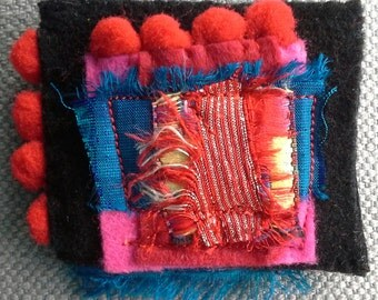 Textile PIN. Composition of primary colors. Original creation.
