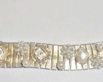 Pretty vintage goldtone watchband style bracelet with clear plastic insets and faux pearl accents