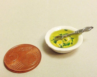 miniature soup in the porcelain plate