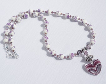 Lilac/white ceramic necklace with lampworked glass and sterling silver drop