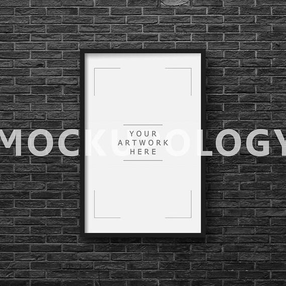 11x17 vertical digital black frame mockup on black brick wall for 11x17 mockup