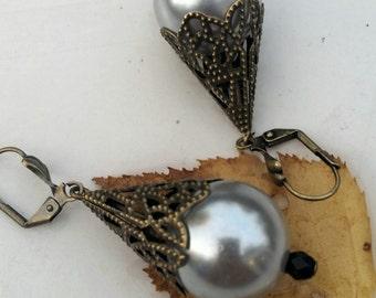 Grey dangle earrings of baroque style