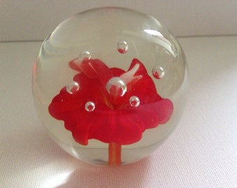 Vintage Round Glass Paperweight With Red Flower Centre.
