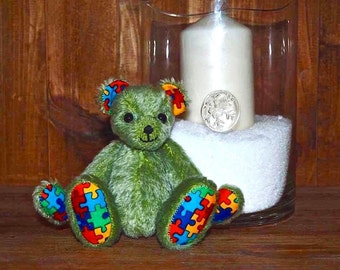 Sold....( but if interested in one similar please contact me ) .. Beautiful quality shulte mohair Autism bear.