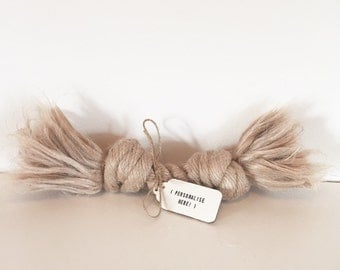Jute rope dog toy with personalised tag