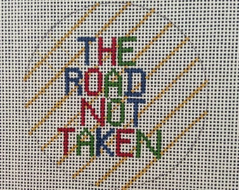 Luggage tag to needlepoint: The road not taken
