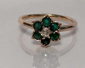 Emerald and diamond ring in 10ct gold