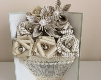 Folded book art vase shape with paper flowers