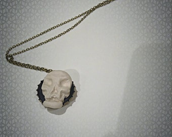 Skull bottle cap necklace