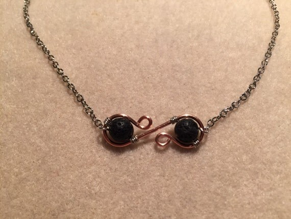 Lava Diffuser Necklace. Elegant Pure Copper Loops Nestling Two Lava Beads for Essential Oil Aromatherapy. 18-inch Chain Included