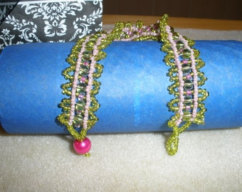 Glass bead bracelet of greens and pinks.