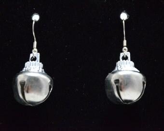 Festive silver bell earrings.