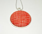 orange crisscross fabric button silver plated pendant