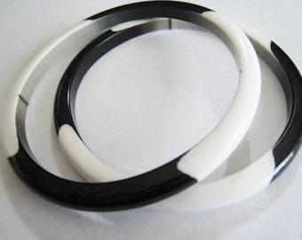 Two Black & White Plastic Bracelets