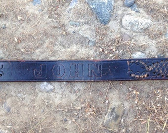 Vintage hand tooled belt, reads John. Has leather wicen scorpins, size 42.