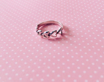 Sterling silver ring with hearts